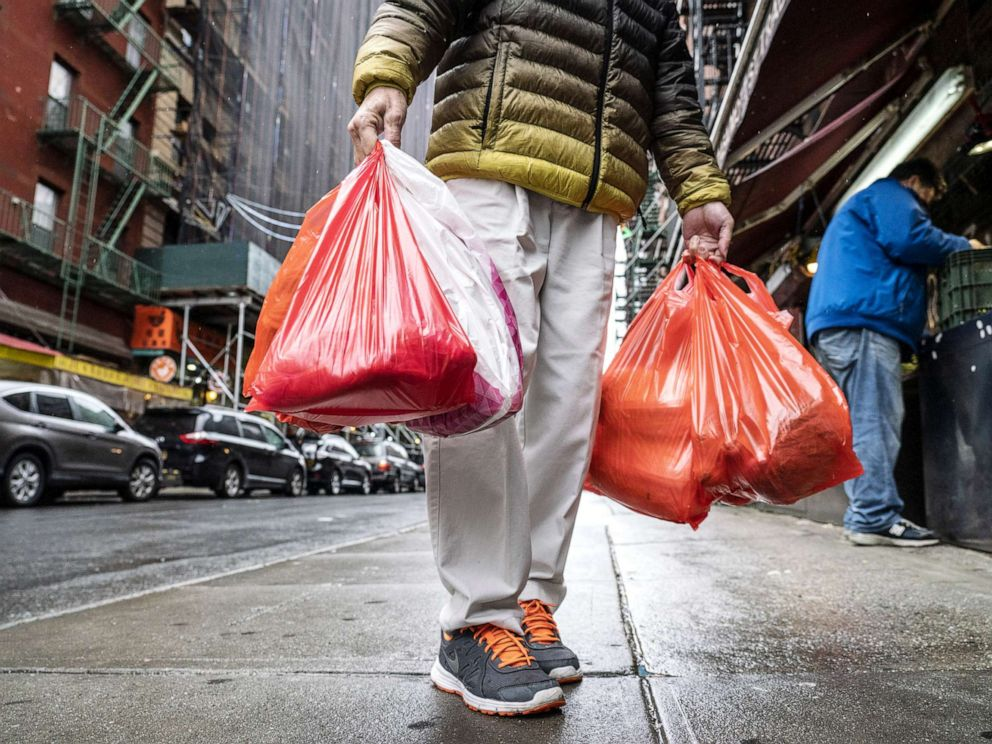 PHOTO: A pedestrian carries plastic shopping bags in New York, March 31, 2019.