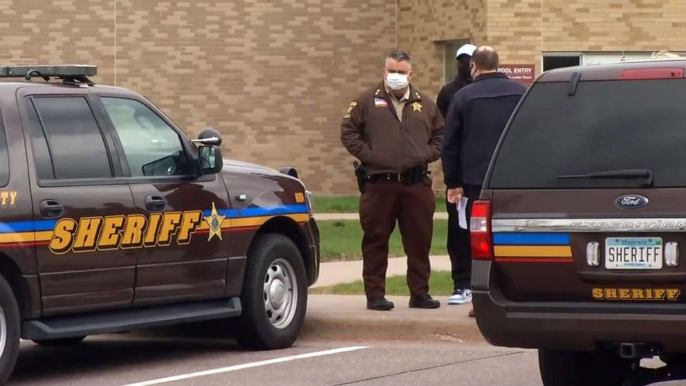 PHOTO: Law enforcement officials stand nearby after reports of a shooting at Plymouth Middle School in Plymouth, Minn., April 26, 2021.