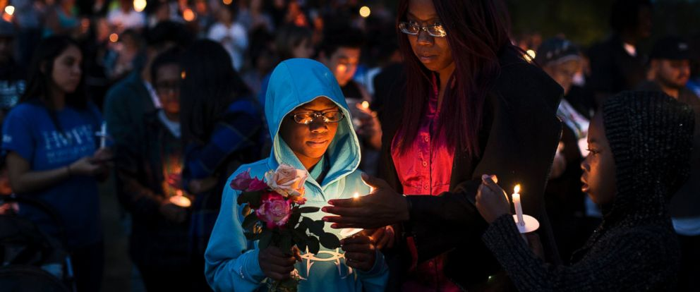 PHOTO: North Park Elementary School students attend a prayer vigil with their mom Laura Beaven the day after student Jonathan Martinez, 8, and teacher Karen Smith were shot and killed in their classroom, April 11, 2017 in San Bernardino, Calif.