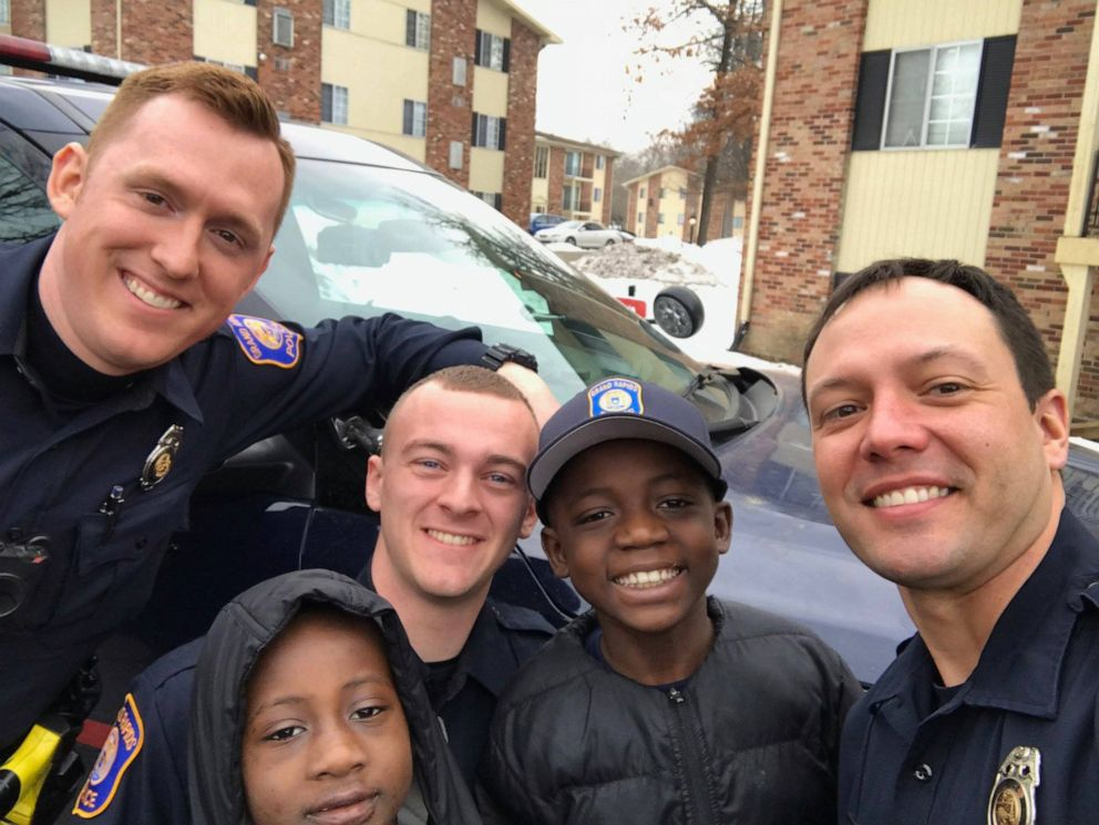 Officers from the Grand Rapids Police Department help celebrate 9-year-old Thomas Daniels birthday.