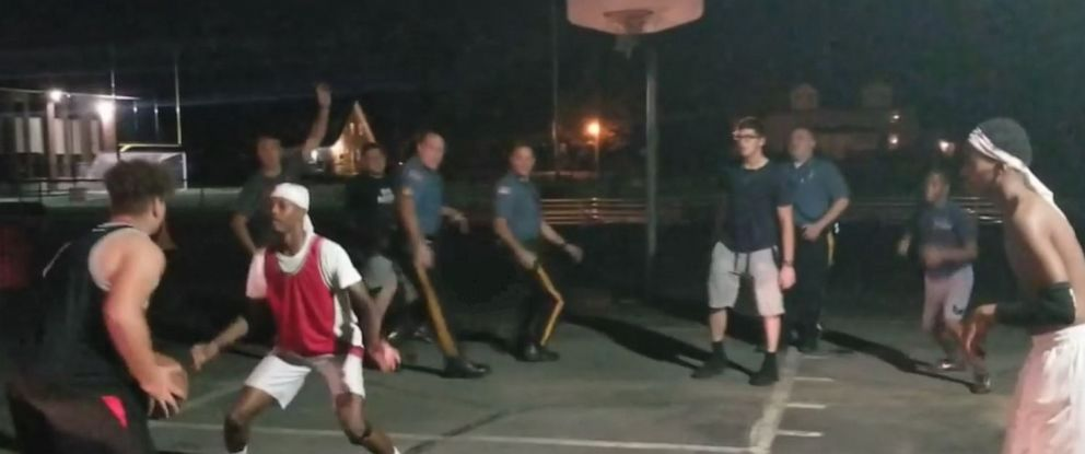 PHOTO: Pompton Lakes (NJ) police officers join in a pick-up basketball game between local youths, Sept. 23, 2019.