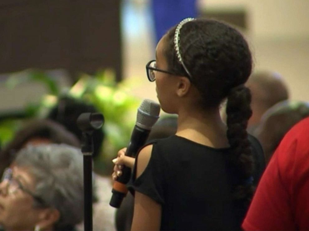 PHOTO: Savannah Taylor, 12, speaks at a community meeting in Phoenix on June 19, 2019, called by the mayor to address a controversial police confrontation with a black family that was caught on viral cell phone video.