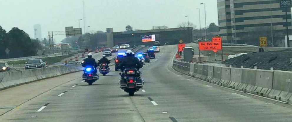 PHOTO: Officers lined up to greet Louie Schneider as he was driven to Arkansas Childrens Hospital, Feb. 28, 2019, in Little Rock, Arkansas.