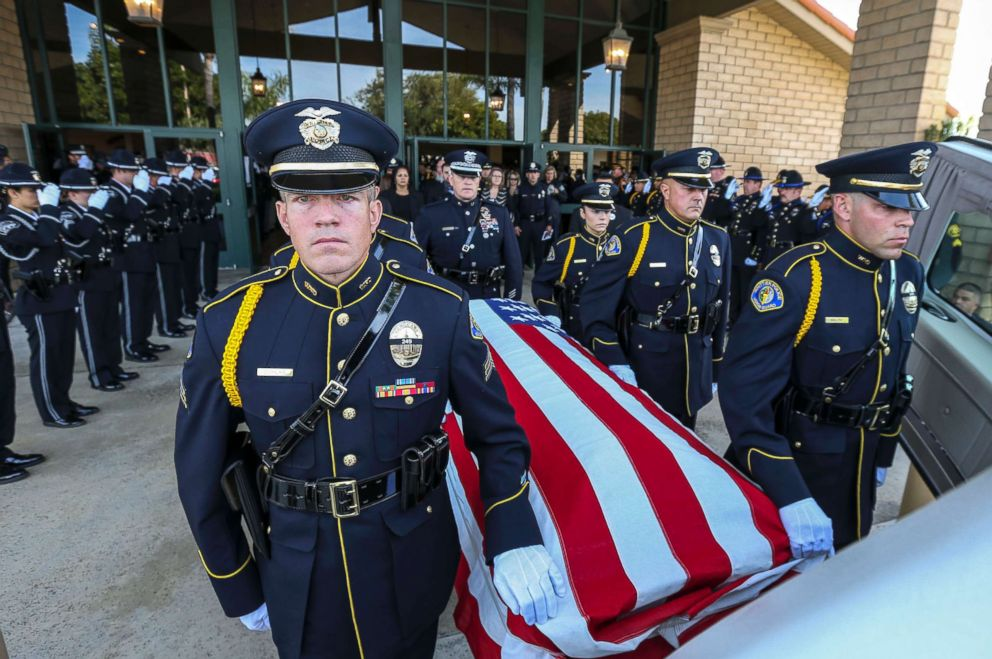 PHOTO: Police officers stand as the funeral procession of slain Whittier police officer Keith Boyer leaves the Calvary Chapel, March 3, 2017 in Downey, Calif. Officer Boyer was shot on killed Feb. 20, 2017, while responding to a traffic accident.