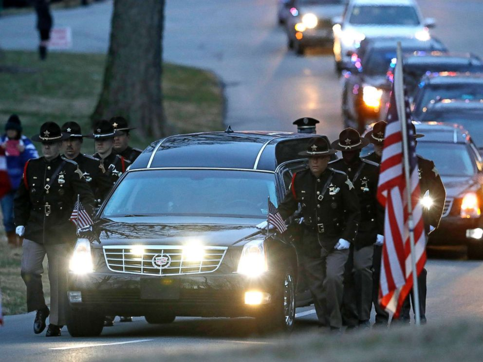 PHOTO: The honor guard walks along the hearse carrying the casket of Boone County Sheriffs Deputy Jacob Pickett, March 9, 2018, in Indianapolis. Pickett was fatally shot March 2, 2018, while chasing a man fleeing from police.