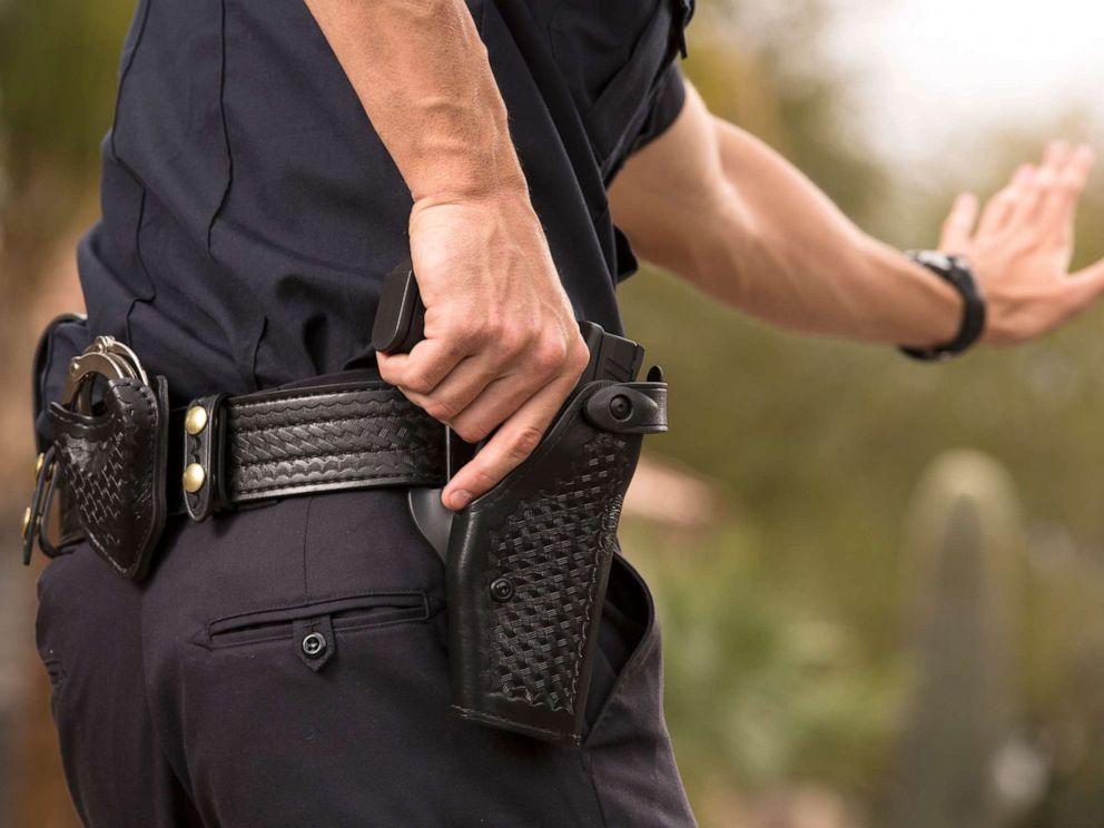PHOTO: A Policeman preparing to draw his gun in a stock photo.