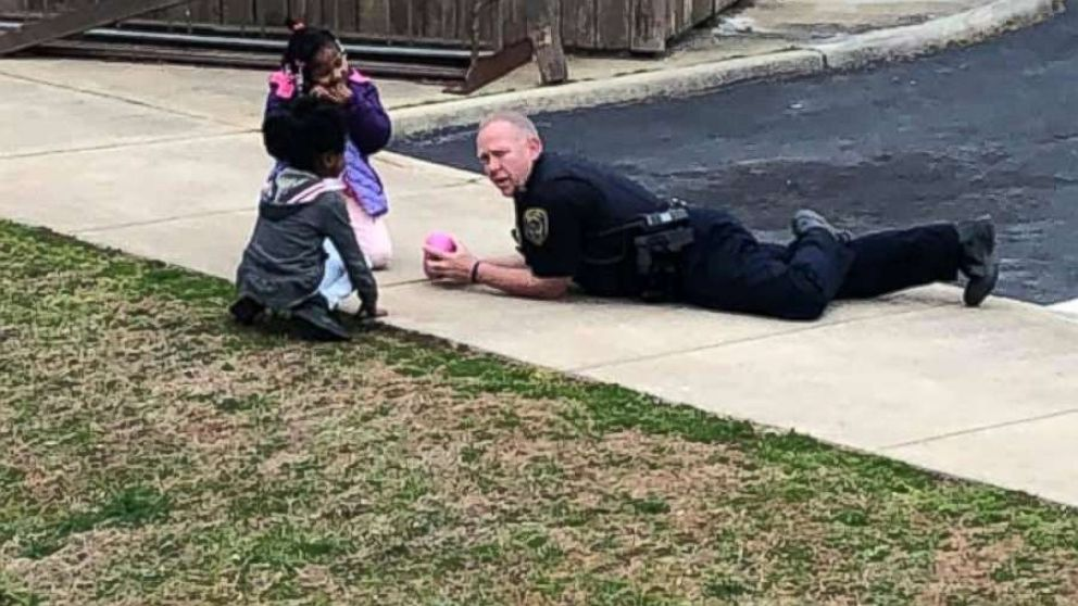 South Hill Police Cpl. C.B. Fleming was seen playing dolls and drawing with sidewalk chalk with children after he responded to a 911 call of a gas leak that turned out to be a false alarm on Feb. 14, 2019.
