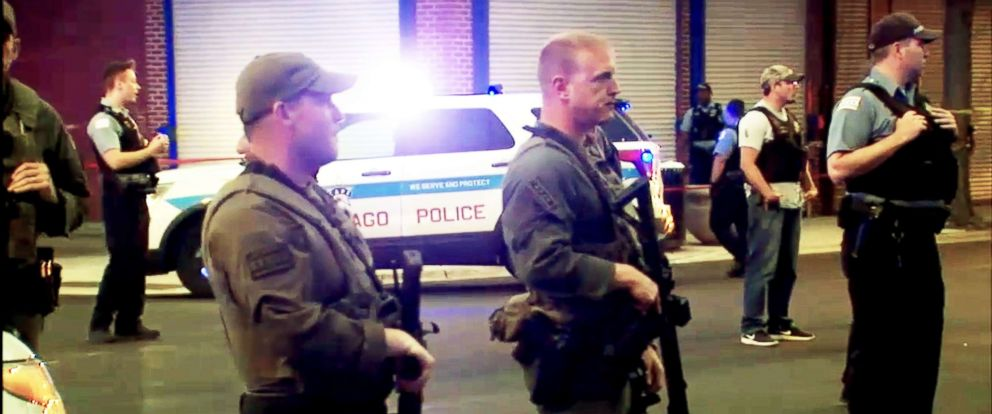 PHOTO: Law enforcement officers respond to the scene of a police-involved shooting in Chicago.