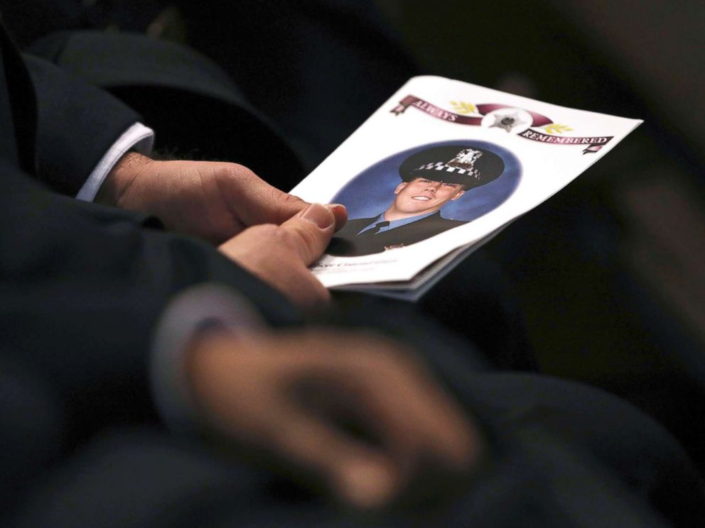 PHOTO: An attendee holds a program as police officers attend the funeral for Chicago police Officer Conrad Gary at St. Rita of Cascia Shrine Chapel in Chicago, Dec. 21, 2018.