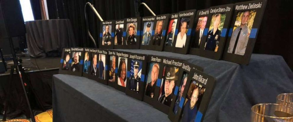 PHOTO: Photos of officers whove taken their lives sit on a table at the 2019 Blue H.E.L.P dinner.