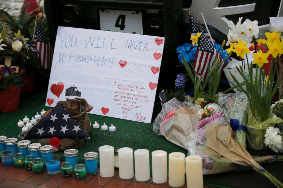 PHOTO: Mourners leave flowers on a police cruiser parked in front of City Hall in Westerville, Ohio, on Feb. 11, 2018.