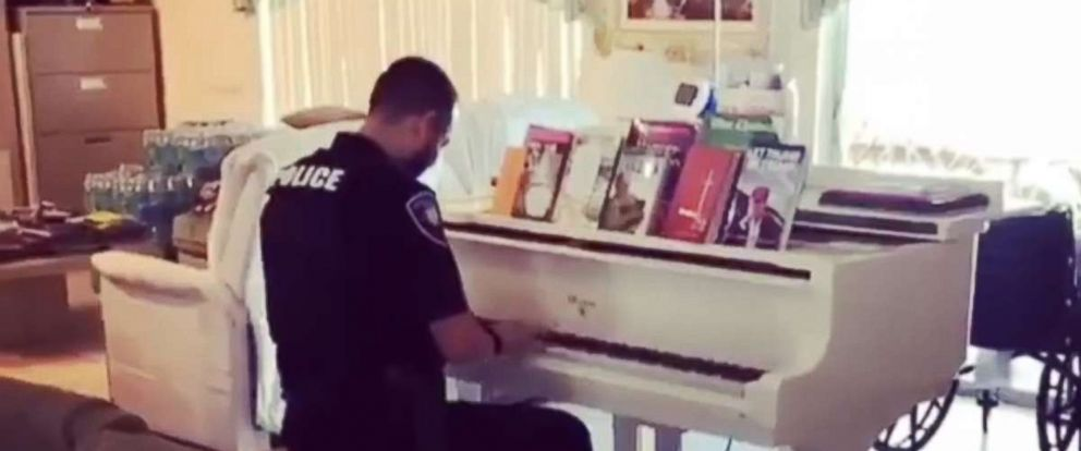 PHOTO: While responding to a medical call for service involving an elderly couple in Spring Valley, Officer Hernandez noticed that the couple owned a piano. To cheer up the couple's daughter he decided to play some songs for her.
