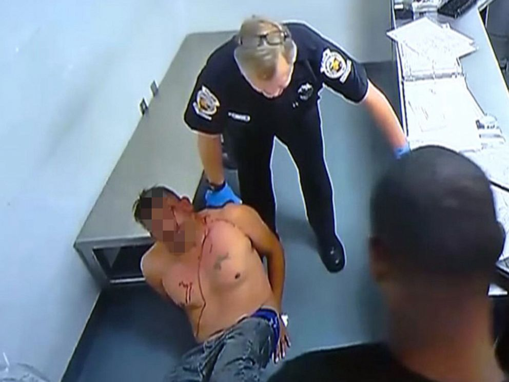 PHOTO: An image made from surveillance footage from inside the Homestead, Fla., police department shows Homestead Police officer Lester Brown pushing an inmate into a wall on Dec. 1, 2018.