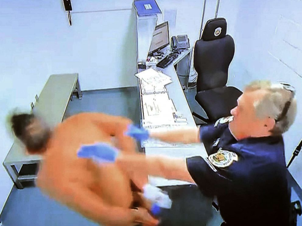 PHOTO: Surveillance footage from inside the Homestead, Fla., police department shows Homestead Police officer Lester Brown pushing a handcuffed inmate into a wall on Dec. 1, 2018.