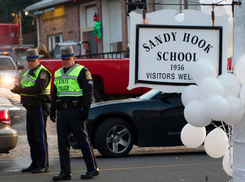 PHOTO: Police stand guard at the entrance after a mass shooting at the Sandy Hook School in Newtown, Conn., Dec. 15, 2012.