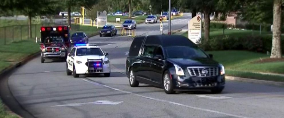 PHOTO: Gwinnett County, Georgia, police and paramedics escort a hearse carrying the body of Officer Antwan Toney from a hospital where he died from a gunshot wound to the Gwinnett County Medical Examiners office on Oct. 20, 2018.