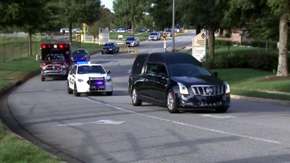 Gwinnett County, Georgia, police and paramedics escort a hearse carrying the body of Officer Antwan Toney from a hospital where he died from a gunshot wound to the Gwinnett County Medical Examiner's office on Oct. 20, 2018.