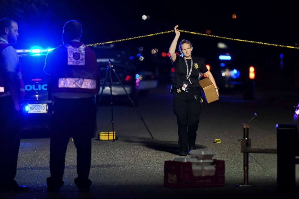 PHOTO: A member of the sheriffs department exits the crime scene on Ashton Drive in the Vintage Place neighborhood where several members of law enforcement were shot, one fatally, Oct. 3, 2018, in Florence, S.C.