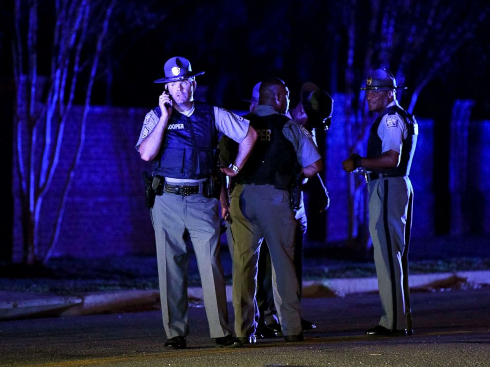 PHOTO: South Carolina state troopers gather near the Vintage Place neighborhood where several law enforcement officers were shot, one fatally, Oct. 3, 2018, in Florence, S.C.