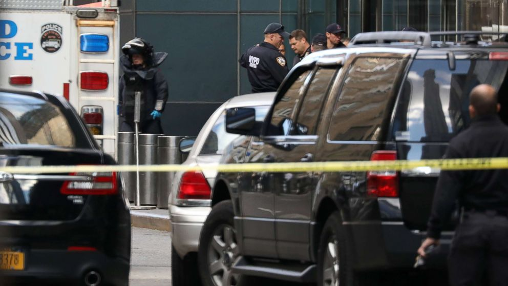 A member of the New York Police Department bomb squad is pictured outside the Time Warner Center in New York City after a suspicious package was found inside the CNN Headquarters.