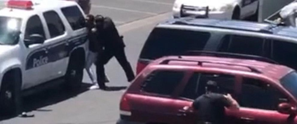 PHOTO: Cellphone video released by police show officers taking two shoplifting suspects into custody in Phoenix, June 11, 2019.
