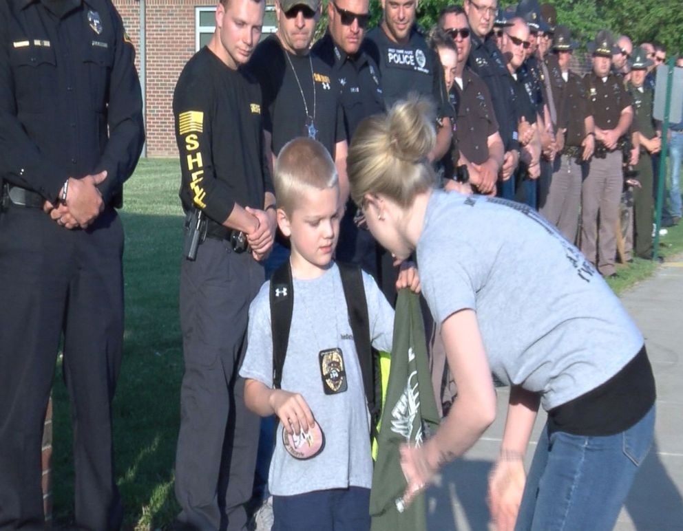 The tragic reason for boy's guard of honour on way to school