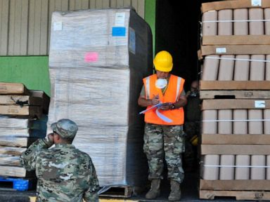 Puerto Rico distributes emergency supplies that were left in old warehouse for years