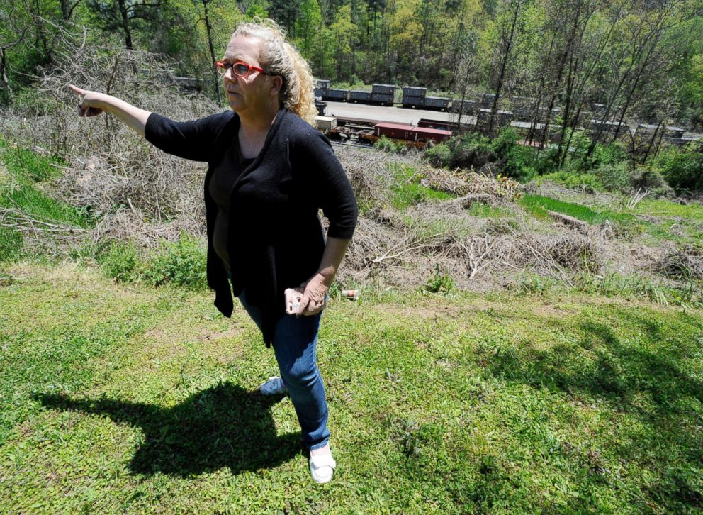 PHOTO: Mayor Heather Hall discusses the nearby train loaded with tons of sewage sludge that is stinking up her community of Parrish, Ala.. April 12, 2018.