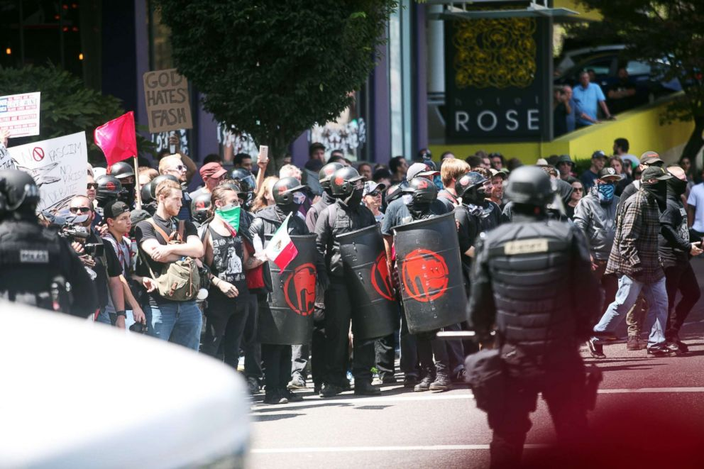 PHOTO: People on all sides of the political spectrum gather for a campaign rally organized by right-wing organizer and Patriot Prayer founder Joey Gibson in Portland, Oregon, August 4, 2018. <p itemprop=