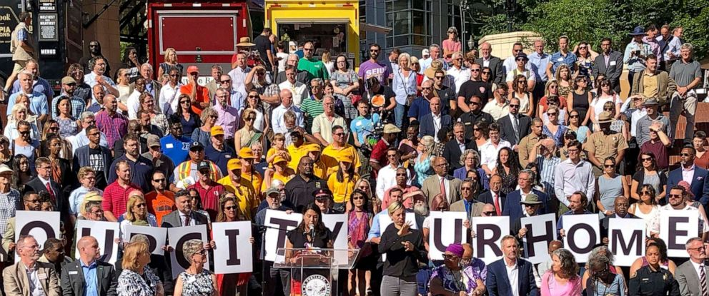 PHOTO: Members of dozens of civic leaders hold up signs spelling out Our City Our Home on Wednesday, Aug. 14, 2019, in Portland, Ore., during a rally to support the city in advance of protests planned for Saturday.