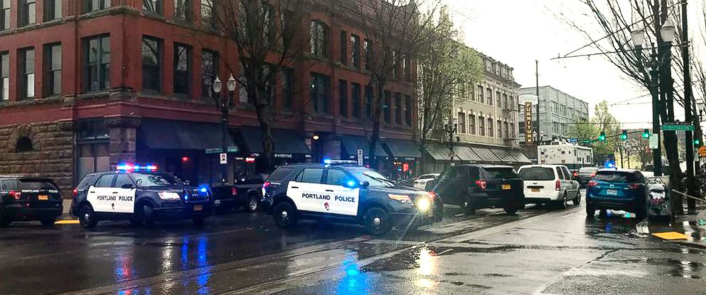 PHOTO: Portland police close a section of a street during an investigation into a shooting inside a homeless shelter in Portland, Ore., April 8, 2018.