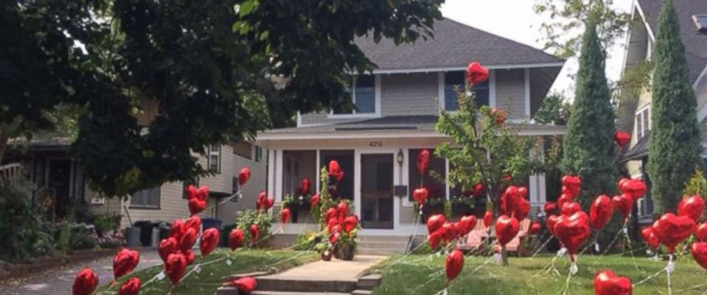 PHOTO: The front yard of Laura Stegengas Minneapolis home was decorated with heart balloons by her mail carrier and neighbors.