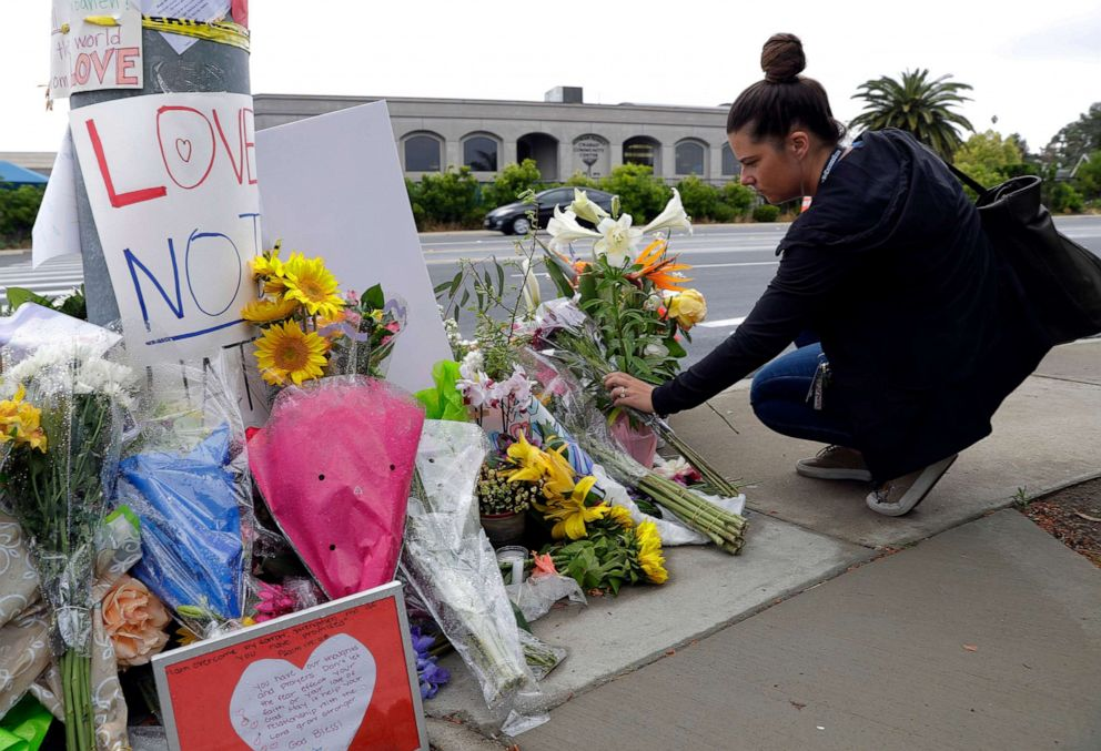 PHOTO: A woman leaves flowers on a growing memorial across the street from the Chabad of Poway synagogue in Poway, Calif., April 29, 2019, following a shooting.