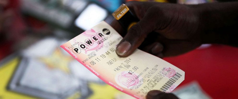 PHOTO: George Hollins buys a Powerball ticket at the Shell Gateway store, March 26, 2019, in Boynton Beach, Florida.