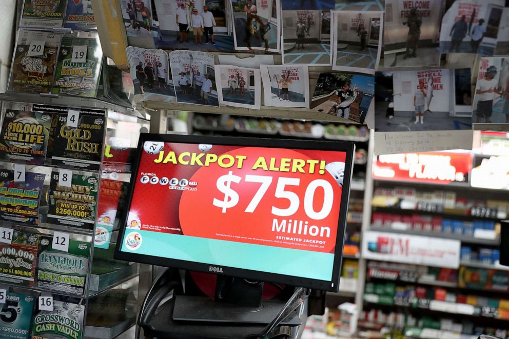 PHOTO: The Powerball jackpot is seen on a sign at the Shell Gateway store, March 26, 2019, in Boynton Beach, Florida.