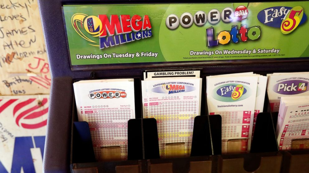In this Tuesday, Oct. 23, 2018 file photo, lottery forms for Louisiana Mega Millions, Powerball and other lottery games fill the drawer at The World Bar and Grill, in Delta, La., a few miles from the Mississippi-Louisiana state line.