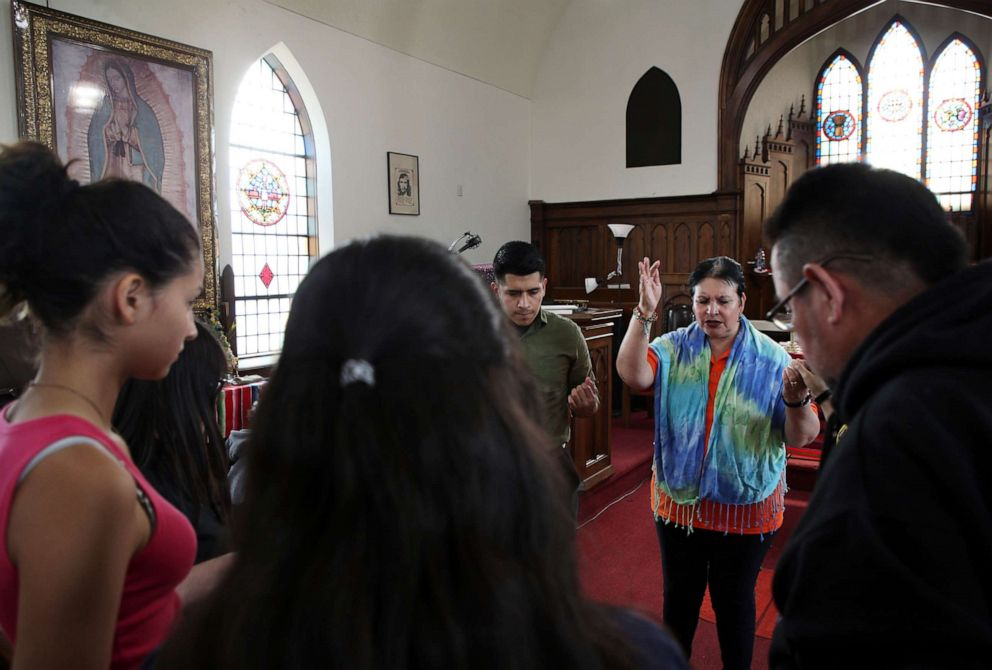PHOTO: Pastor Jacobita Cortes offers a prayer at Lincoln United Methodist Church in Chicago, May 15, 2019, for Marlen Ochoa Terrence Antonio James / AP </span> </picture></div><figcaption><span class=