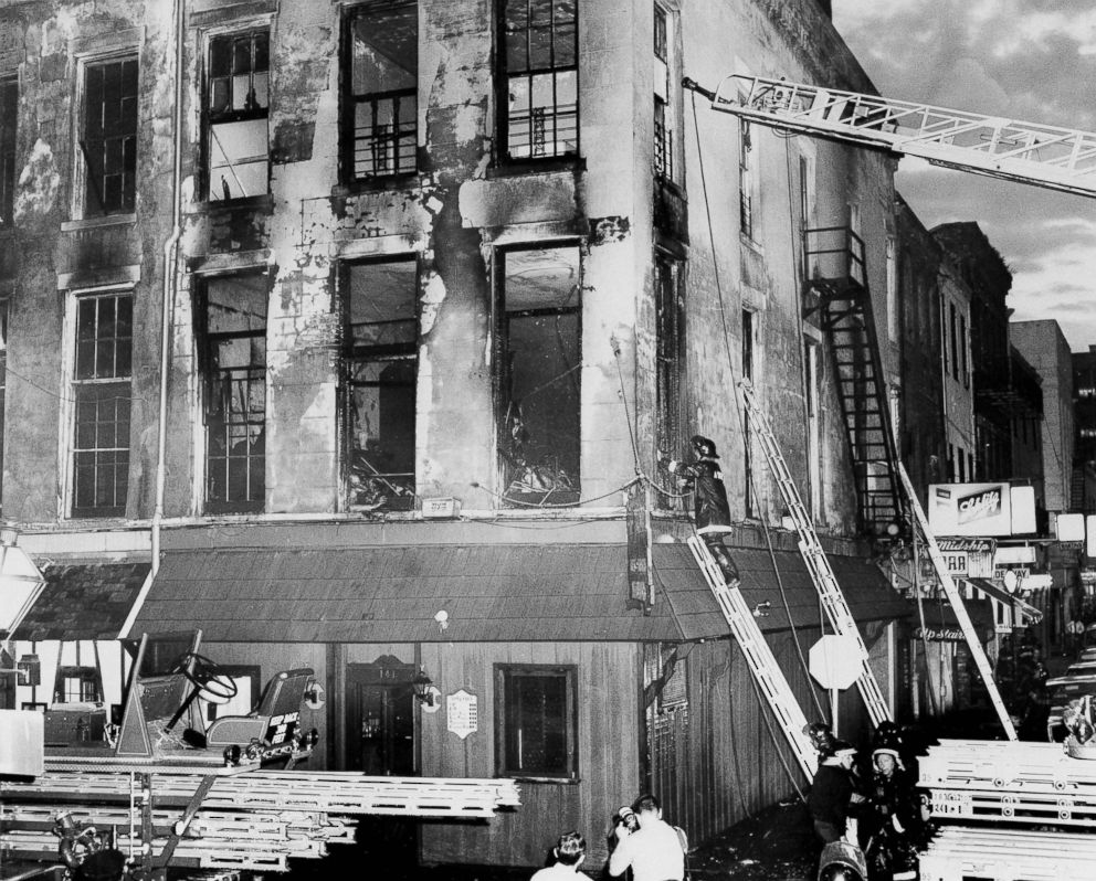 A firefighter examines the remains of the UpStairs Lounge on June 24, 1973, after a fire that left 32 dead.
