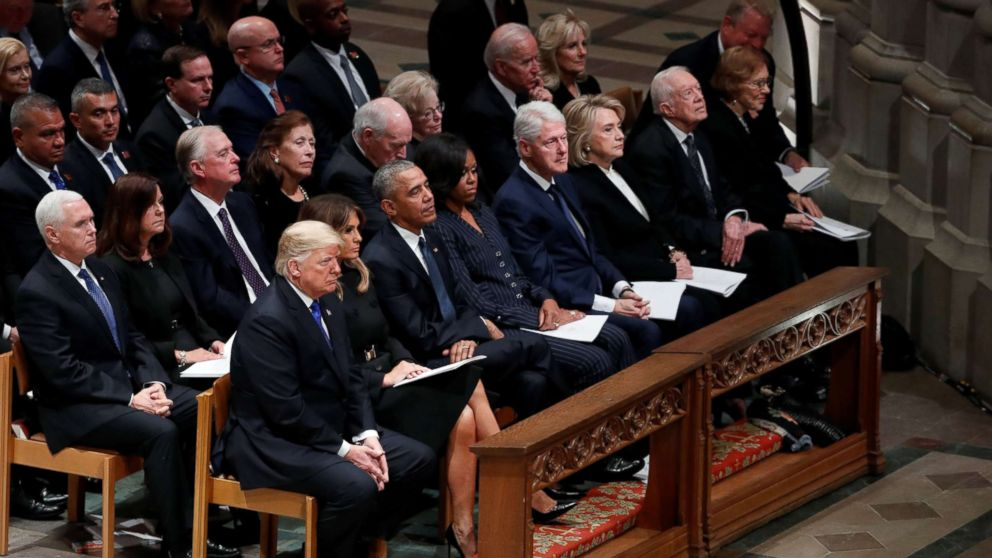 President Donald Trump sits with first lady Melania Trump, former President Barack Obama, former first lady Michelle Obama, former President Bill Clinton and former first lady Hillary Clinton, former President Jimmy Carter and first lady Rosalynn Carter in the front row at the state funeral for former President George H.W. Bush at the Washington National Cathedral in Washington, Dec. 5, 2018.