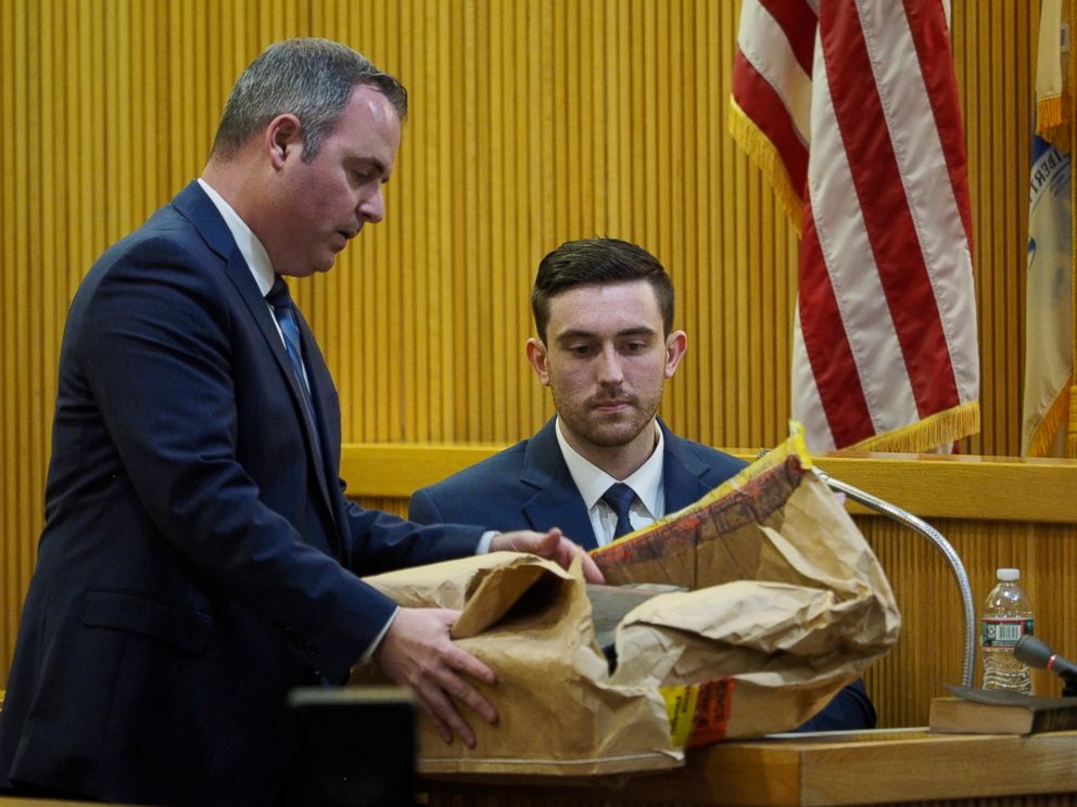 Monmouth County Assistant Prosecutor Christopher Decker presents evidence to Preston Taylor, a witness for the prosecution, during the murder trial of Liam McAtasney at the Monmouth County courthouse, Jan. 23, 2019, in Freehold, N.J.
