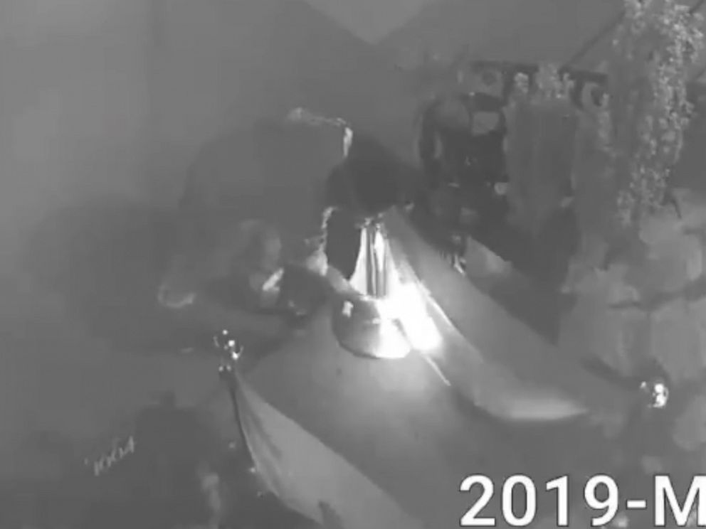 PHOTO: An image made from video released by the NYPD Crime Stoppers shows a person setting fire to two rainbow pride flags in front of the Alibi Lounge in the Harlem borough of New York, May 31, 2019.