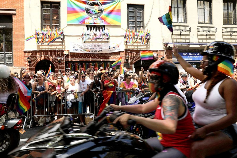 PHOTO: People on motorcycles make their way past the Stonewall Inn during the annual New York Gay Pride Parade, one of the oldest and largest in the world, in the West Village of Manhattan, June 25, 2017, in New York City.