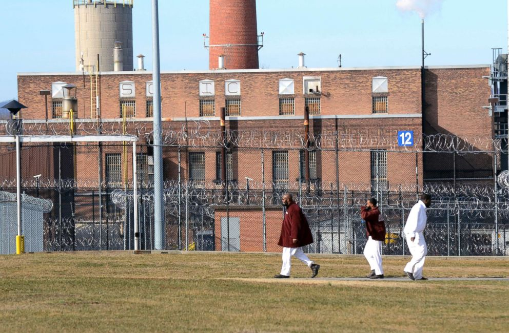 PHOTO: Inmates walk across a yard at the State Correctional Institution at Camp Hill, Jan. 13, 2017, in Camp Hill, Penn.