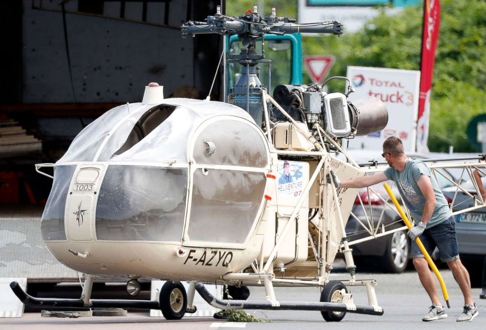 PHOTO: Investigators transport an Alouette II helicopter allegedly abandoned by French prisoner Redoine Faid and suspected accomplices after his escape from the prison of Reau, in Gonesse, north of Paris, France, July 1, 2018.