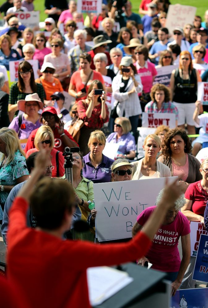 PHOTO: The crowd watches as Stephanie Kight, President and CEO of Planned Parenthood of Greater Ohio, speaks during the We Wont Go Back Statehouse Rally organized by more than 55 Ohio groups at the Ohio Statehouse, Oct. 2, 2013, in Columbus, Ohio.
