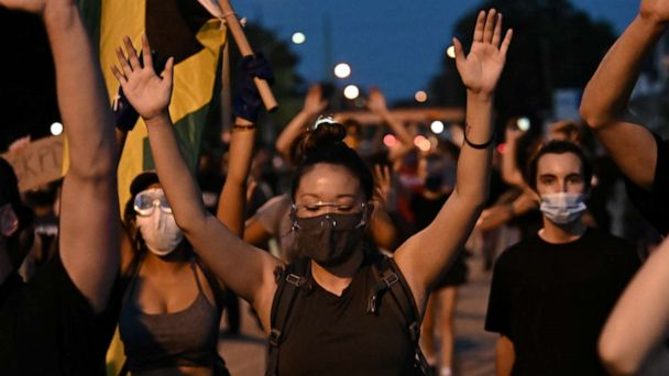 PHOTO: Demonstrators take part in a protest against the police shooting of Jacob Blake in Kenosha, Wisconsin, on Aug. 26, 2020.