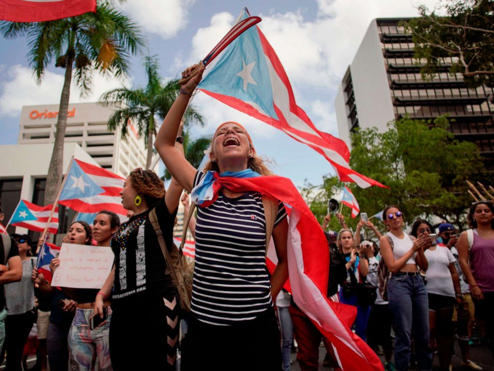 PHOTO: People march in San Juan, July 25, 2019, one day after the resignation of Puerto Rico Governor Ricardo Rossello.