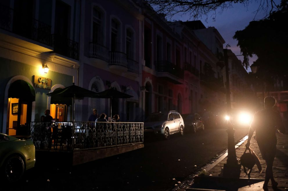 PHOTO: Tourists dine Cafe Puerto Rico on April 18, 2018 in Old San Juan, Puerto Rico as a major failure knocked out the electricity, leaving the entire island without power nearly seven months after Hurricane Maria destroyed the electrical grid.