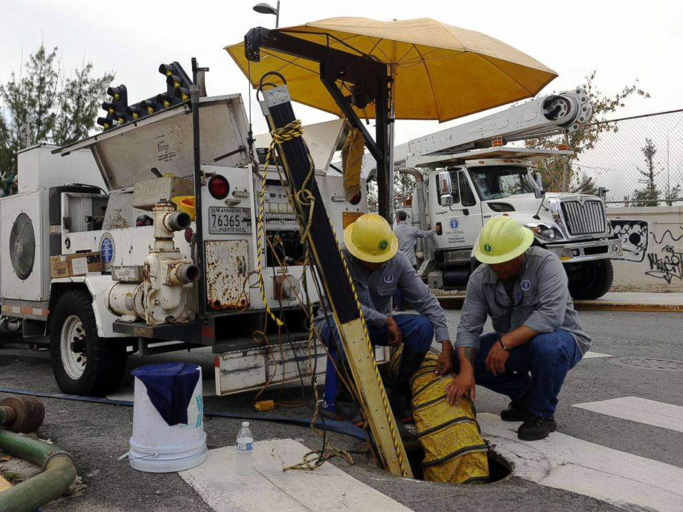 PHOTO: Employees of the Electric Power Authority of Puerto Rico take advantage of a general blackout to repair a damaged line in San Juan, Puerto Rico, April 18, 2018.