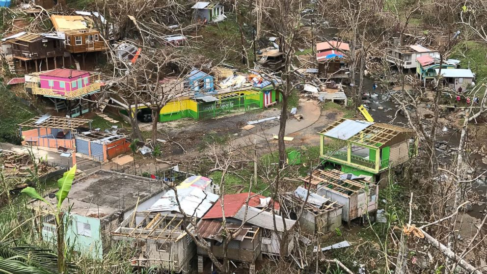 The Puerto Rico town of Comerío lays in tatters with most of the roofs were ripped off and trees stripped by Hurricane Maria, Oct. 5, 2017.